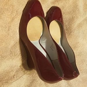 Used Calvin Klein wedged heels with round toe. Wor